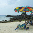 Tropical beach scenery with parasols in Thailand — Stock Photo #30313779