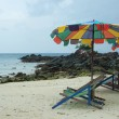 Tropical beach scenery with parasols in Thailand — Stock Photo