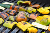 Piece of peppers and zucchini on the grill grate — Stock Photo
