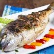 Stock Photo: Grilled gilt head sebream on plate with lemon ,salad and grill