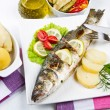 Stock Photo: Fish, sea bass grilled with lemon ,salad and potatoes