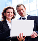 Busy business people working with laptop — Stock Photo
