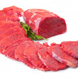 Huge red meat chunk and steak isolated over white background — Stock Photo