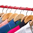 Stock Photo: Lots of T-shirts on hangers