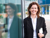 Young confident businesswoman with personal organizer near the — Stock Photo
