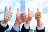 Business People with Thumbs Up — Stock Photo