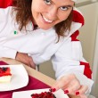 Beautiful young chef decorating delicious dessert — Stock Photo #31576249
