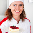 Beautiful young chef with dessert  — Photo