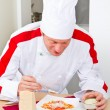 Stock Photo: Chef garnish Italipastdish