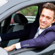Happy man in his new car — Stock Photo