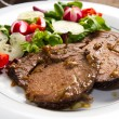 Beef  garnished with fresh salad — Stock Photo