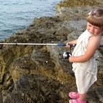 Little fisher girl — Stock Photo #34400935