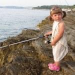 Little fisher girl — Stock Photo #34404747