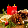 Christmas candle with pine cone — Stock Photo