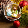 Christmas decoration and crib on wooden table — Stock Photo #34920739