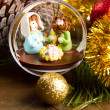 Christmas decoration and crib on wooden table — Stock Photo