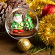 Christmas decoration and santa claus chocolate on wooden table — Stock Photo #34929731