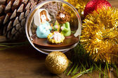 Christmas decoration and crib on wooden table — Stockfoto