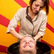 Stock Photo: Washing mhair in beauty parlour hairdressing salon
