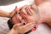 Man getting massage in thebeauty center — Stock Photo
