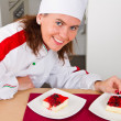 Stock Photo: Beautiful young chef with dessert