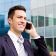 Portrait of a young businessman talking on the phone  — Стоковая фотография
