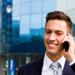 Portrait of a young businessman talking on the phone  — Foto de Stock