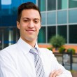 A handsome young business man at office building — Stock Photo