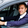 Portrait of an handsome guy driving his car — Stockfoto