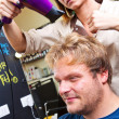 Beautiful man at the hairdresser blow drying his hair — Стоковая фотография