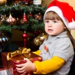 Happy child in Santa hat opening Christmas gift box  — Foto Stock