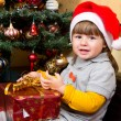 Happy child in Santa hat opening Christmas gift box — Φωτογραφία Αρχείου #36967981