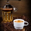 Coffee Grinder with Beans and coffe cup — Stock Photo