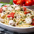 Spaghetti with cuttlefish and tomatoes — Stock Photo