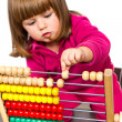 Lovely little girl learning with abacus — Stock Photo