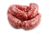 A fresh sausage isolated on white background — Stock Photo