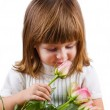 Beautiful little girl with roses flowers — Stock Photo