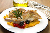Baked rabbit with olives and pepper — Stock Photo
