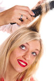Blonde girl at the hairdresser — Stock Photo