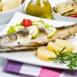 Fish, sea bass grilled with lemon ,salad and potatoes — Stock Photo