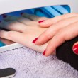 Stock Photo: Hands with uv lamp for nails