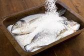 Gilt head sea bream baked in sea salt — Stock Photo