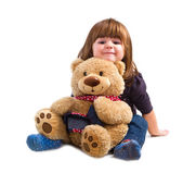 Little girl holding a teddy bear — Stock Photo