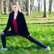 Pretty woman doing exercises in the park — Stock Photo #41866071