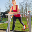 Stock Photo: Portrait of cheerful woman in fitness wear exercising with equip