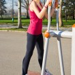 Portrait of cheerful woman in fitness wear exercising with equip — Stock Photo
