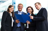 Confident employees discussing document at meeting  — Foto de Stock