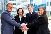 Business people joining hands — Foto Stock