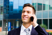 Portrait of a young businessman talking on the phone  — Stock Photo