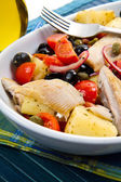 Mackerels with potatoes,tomatoes,capers and olives — Stock Photo